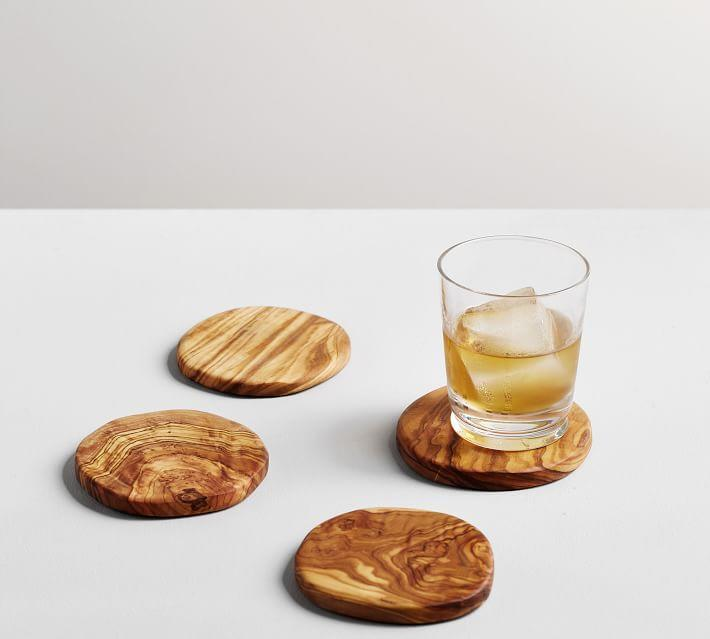 """<br><br><strong>Pottery Barn</strong> Olive Wood Coasters, Set of 4, $, available at <a href=""""https://go.skimresources.com/?id=30283X879131&url=https%3A%2F%2Fwww.potterybarn.com%2Fproducts%2Folivewood-coasters"""" rel=""""nofollow noopener"""" target=""""_blank"""" data-ylk=""""slk:Pottery Barn"""" class=""""link rapid-noclick-resp"""">Pottery Barn</a>"""