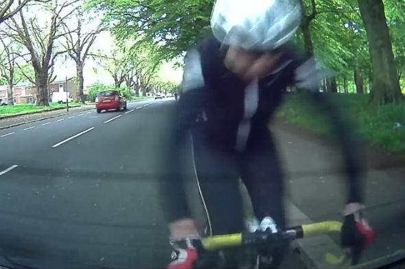 Cyclist crashes into parked car