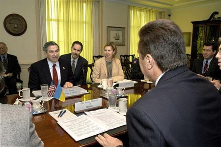 FILE PHOTO: Deputy Secretary of Defense Paul Wolfowitz hosts a Pentagon meeting next to his interpreter Peter Fedynsky, Deputy Assistant Secretary of Defense for Eurasian Policy, Mira Ricardel and Ukrainian Prime Minister Viktor Yanukovych at the Pentagon in Washington, U.S., October 9, 2003 and obtained November 13, 2018. Courtesy R.D. Ward/U.S. Department of Defense/Handout via REUTERS