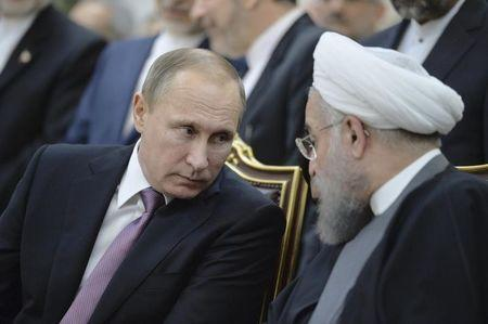Russian President Vladimir Putin and his Iranian counterpart Hassan Rouhani attend a signing ceremony in Tehran