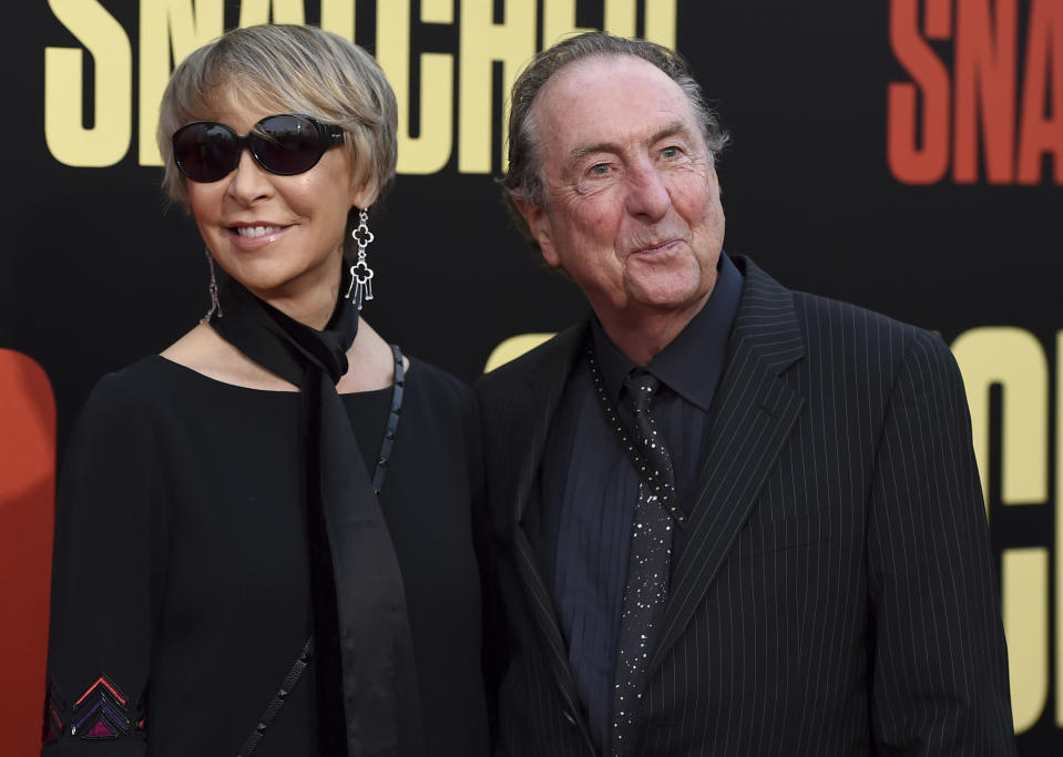 Tania Kosevich, left, and Eric Idle. (Credit: Jordan Strauss/Invision/AP)