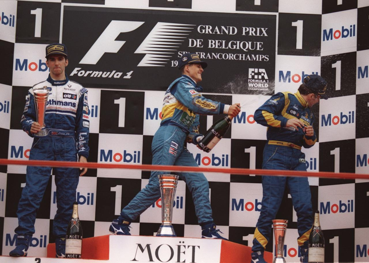 27 Aug 1995: MICHAEL SCHUMACHER OF GERMANY AND THE BENETTON RENAULT TEAM SPRAYS CHAMPAGNE OVER THIRD PLACE DRIVER MARTIN BRUNDLE OF ENGLAND AND THE LIGIER MUGEN-HONDA TEAM AS DAMON HILL OF ENGLAND AND THE WILLIAMS RENAULT TEAM LOOKS ON IN DISAPPOINTMENT A