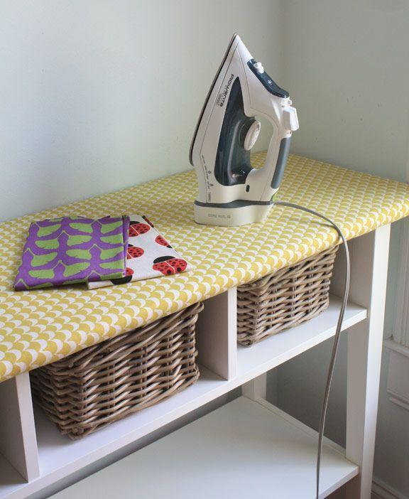 """<p>A traditional ironing board eats up valuable room with its X-like frame (and who actually folds it up after <em>every</em> use?). This clever IKEA hack turns the top of a long table into an ironing space, and offers spots for baskets underneath.</p><p><a href=""""http://thelongthread.com/?p=11117="""" rel=""""nofollow noopener"""" target=""""_blank"""" data-ylk=""""slk:See more at The Long Thread »"""" class=""""link rapid-noclick-resp""""><em>See more at The Long Thread »</em></a></p>"""