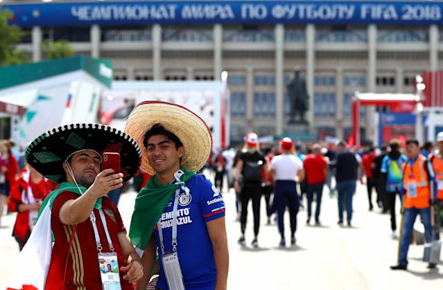 <p>Mexico fans take a selfie outside the stadium ahead of kick off. (Rex) </p>