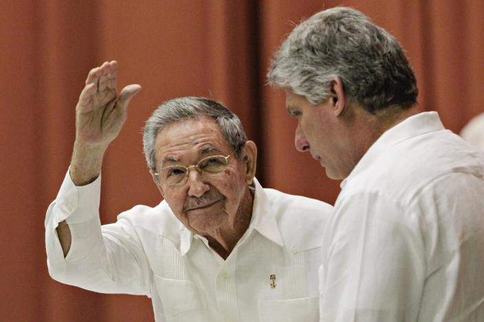 RNPS: YEAREND REVIEW 2014: POLITICS Cuba's President Raul Castro (L), gestures beside first vice-president Miguel Diaz Canel, after delivering a speech to members of the National Assembly in Havana, in this December 20, 2014 file photo. Stepping out of his legendary brother's shadow, President Raul Castro has scored a diplomatic triumph and a surge in popular support with the deal that ends decades of open hostility with the United States. REUTERS/Stringer (CUBA - Tags: POLITICS TPX IMAGES OF THE DAY)