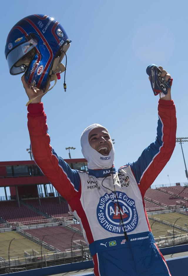 FONTANA, CA - AUGUST 29: Brazilian Helio Castroneves, driver of the #3 Team Penske Dallara Chevrolet, celebrates after earning pole position during qualifying for the Verizon IndyCar Series MAVTV 500 IndyCar World Championship Race at the Auto Club Speedway on August 29, 2014 in Fontana, California. Robert Laberge/Getty Images/AFP (AFP Photo/ROBERT LABERGE)