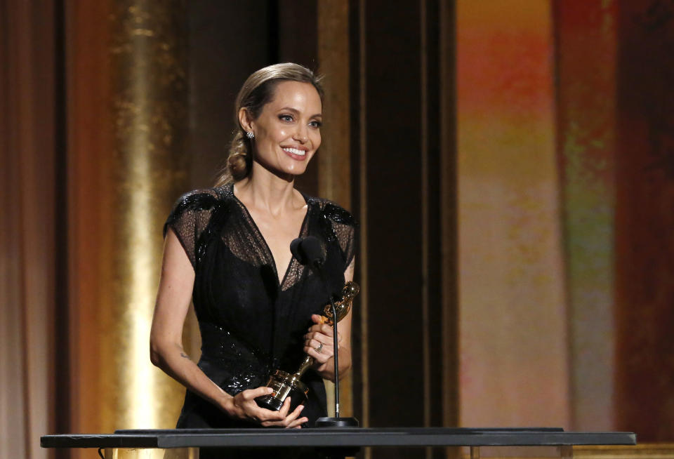 Actress Angelina Jolie accepts the Jean Hersholt Humanitarian Award at the 5th Annual Academy of Motion Picture Arts and Sciences Governors Awards at The Ray Dolby Ballroom in Hollywood, California November 16, 2013.  REUTERS/Mario Anzuoni (UNITED STATES  - Tags: ENTERTAINMENT)