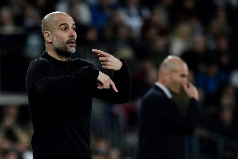 Manchester City manager Pep Guardiola (left) takes on Real Madrid coach Zinedine Zidane (right) when the Champions League resumes on Friday (AFP Photo/JAVIER SORIANO)