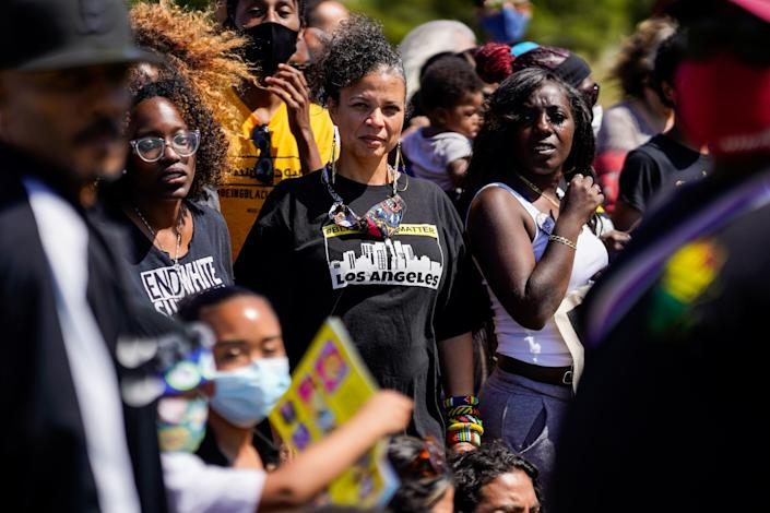 "Melina Abdullah, center, stands with others for a group photo at a Black Lives Matter event June 6 at Norman O. Houston Park in Baldwin Hills. <span class=""copyright"">(Kent Nishimura / Los Angeles Times)</span>"