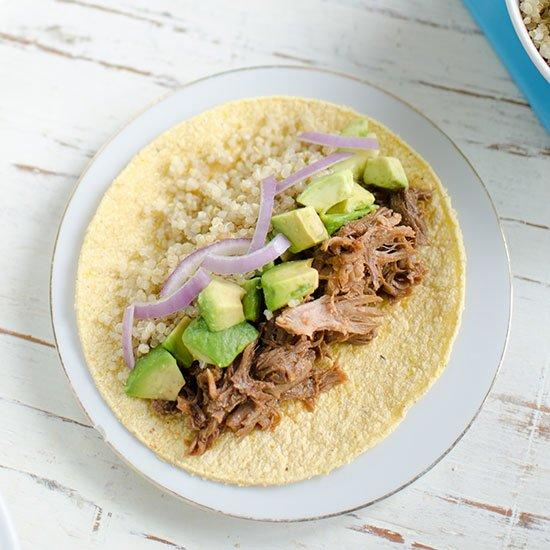 "<p>Tart avocado salsa and crunchy red onions accompany these full-of-flavor BBQ pulled pork tacos; quinoa adds a healthy twist.</p><p><a href=""https://www.foodandwine.com/recipes/bbq-shredded-pork-and-quinoa-tacos"">GO TO RECIPE</a></p>"