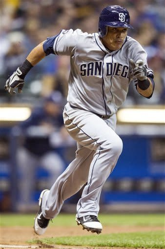 San Diego Padres' Everth Cabrera tries to reach base on an infield single but was called out at first against the Milwaukee Brewers during the third inning of a baseball game, Wednesday, Oct. 3, 2012, in Milwaukee. (AP Photo/Tom Lynn)