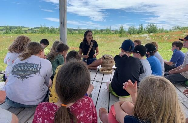 Kelly Sark from Lennox Island First Nation talks to students at École Saint-Augustin Friday about Mi'kmaq traditions.  (Tony Davis/CBC - image credit)