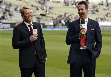 Former cricketers Warne of Australia and Vaughan of England laugh as they commentate before ICC Champions Trophy Group A match between England and Australia in Birmingham