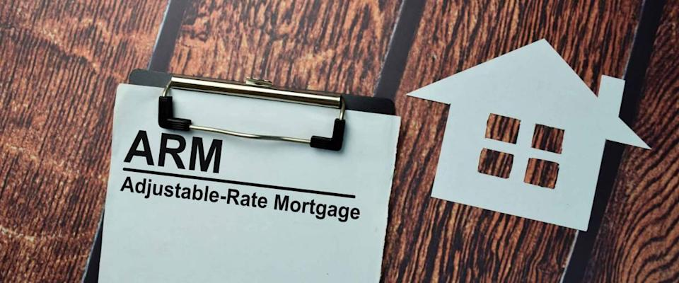 ARM - Adjustable Rate Mortgage write on some paperwork isolated on the desk.