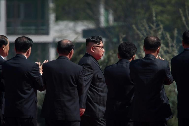 North Korea's leader Kim Jong-Un (C) drew praise from members of the audience for his efforts