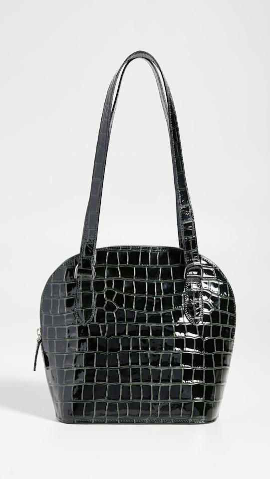 """<p>Go anywhere, do anything in this iconic <a href=""""https://www.popsugar.com/buy/Maryam-Nassir-Zadeh-Pisa-Bag-483871?p_name=Maryam%20Nassir%20Zadeh%20Pisa%20Bag&retailer=shopbop.com&pid=483871&price=515&evar1=fab%3Aus&evar9=45692490&evar98=https%3A%2F%2Fwww.popsugar.com%2Fphoto-gallery%2F45692490%2Fimage%2F46536281%2FMaryam-Nassir-Zadeh-Pisa-Bag&list1=shopping%2Caccessories%2Cbags&prop13=api&pdata=1"""" rel=""""nofollow"""" data-shoppable-link=""""1"""" target=""""_blank"""" class=""""ga-track"""" data-ga-category=""""Related"""" data-ga-label=""""https://www.shopbop.com/pisa-bag-maryam-nassir-zadeh/vp/v=1/1537797027.htm?folderID=13505&amp;fm=other-viewall&amp;os=false&amp;colorId=11E30"""" data-ga-action=""""In-Line Links"""">Maryam Nassir Zadeh Pisa Bag</a> ($515).</p>"""