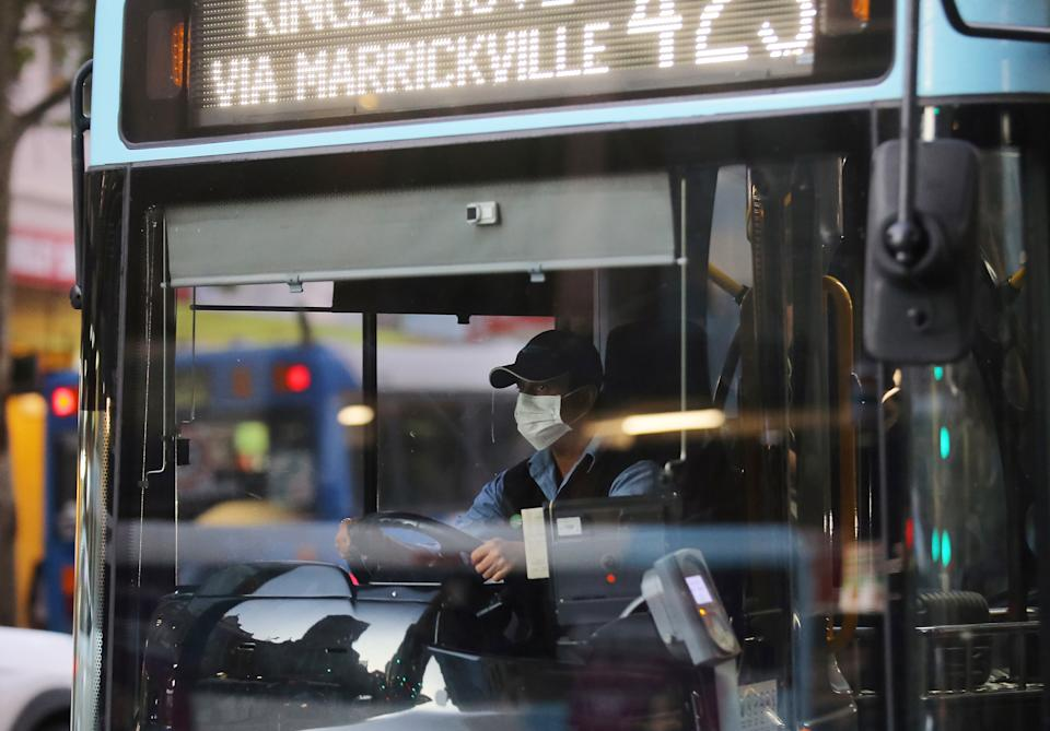 Photo shows a bus driver wearing a face mask in Sydney. Source: AAP