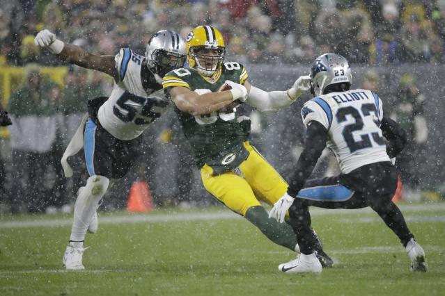 Green Bay Packers' Jimmy Graham tries to get past Carolina Panthers' Bruce Irvin and Javien Elliott during the second half of an NFL football game Sunday, Nov. 10, 2019, in Green Bay, Wis. The Packers won 24-16. (AP Photo/Mike Roemer)