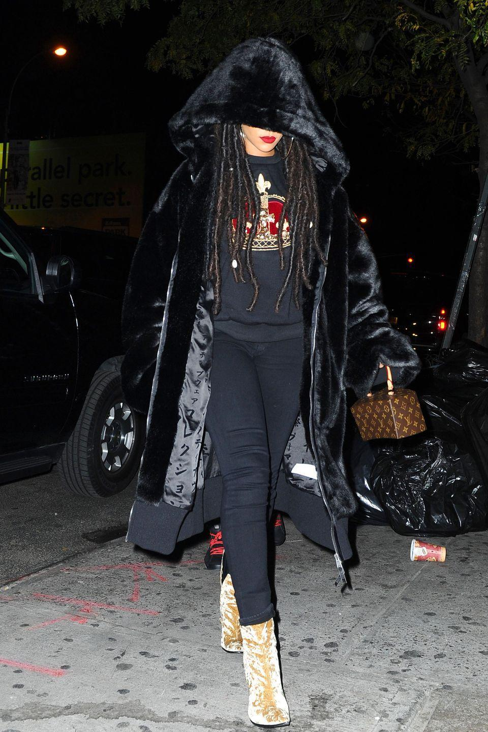 <p>In a hooded velvet coat, embroidered crown sweatshirt, black skinny jeans, beige crushed velvet booties and a Louis Vuitton bag while out in New York. </p>