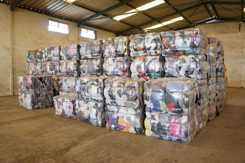 Multi-colored bales of used clothing