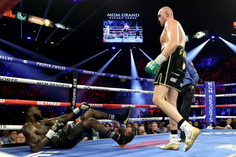Tyson Fury floors Deontay Wilder during their second fight in Las Vegas last year (AFP/AL BELLO)