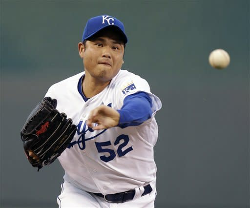 Kansas City Royals starting pitcher Bruce Chen throws during the first inning of a baseball game against the Detroit Tigers, Wednesday, Aug. 29, 2012, in Kansas City, Mo. (AP Photo/Charlie Riedel)