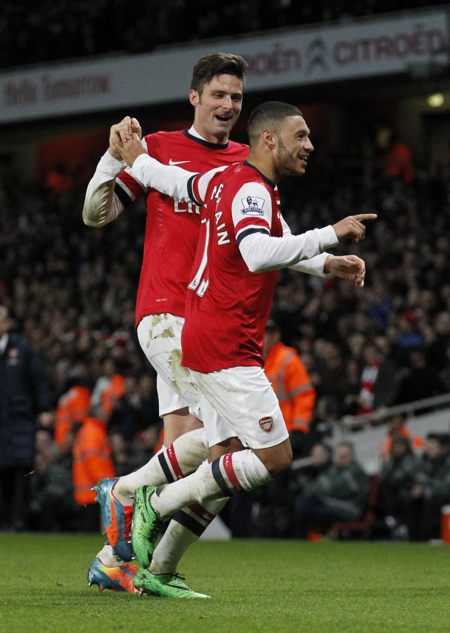 Arsenal's Alex Oxlade-Chamberlain, right, celebrates his his second against Crystal Palace with teammate Olivier Giroud during their English Premier League soccer match at Emirates Stadium in London, Sunday, Feb. 2, 2014. (AP Photo/Sang Tan)