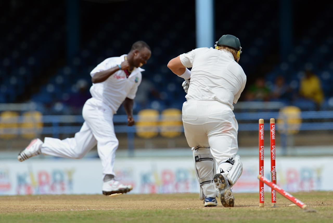 West Indies bowler Kemar Roach (L) celebrates the wicket of Australian batsman Shane Watson (R) during the fourth day of the second-of-three Test matches between Australia and West Indies April 18, 2012 at Queen's Park Oval in Port of Spain, Trinidad. AFP PHOTO/Stan HONDA (Photo credit should read STAN HONDA/AFP/Getty Images)