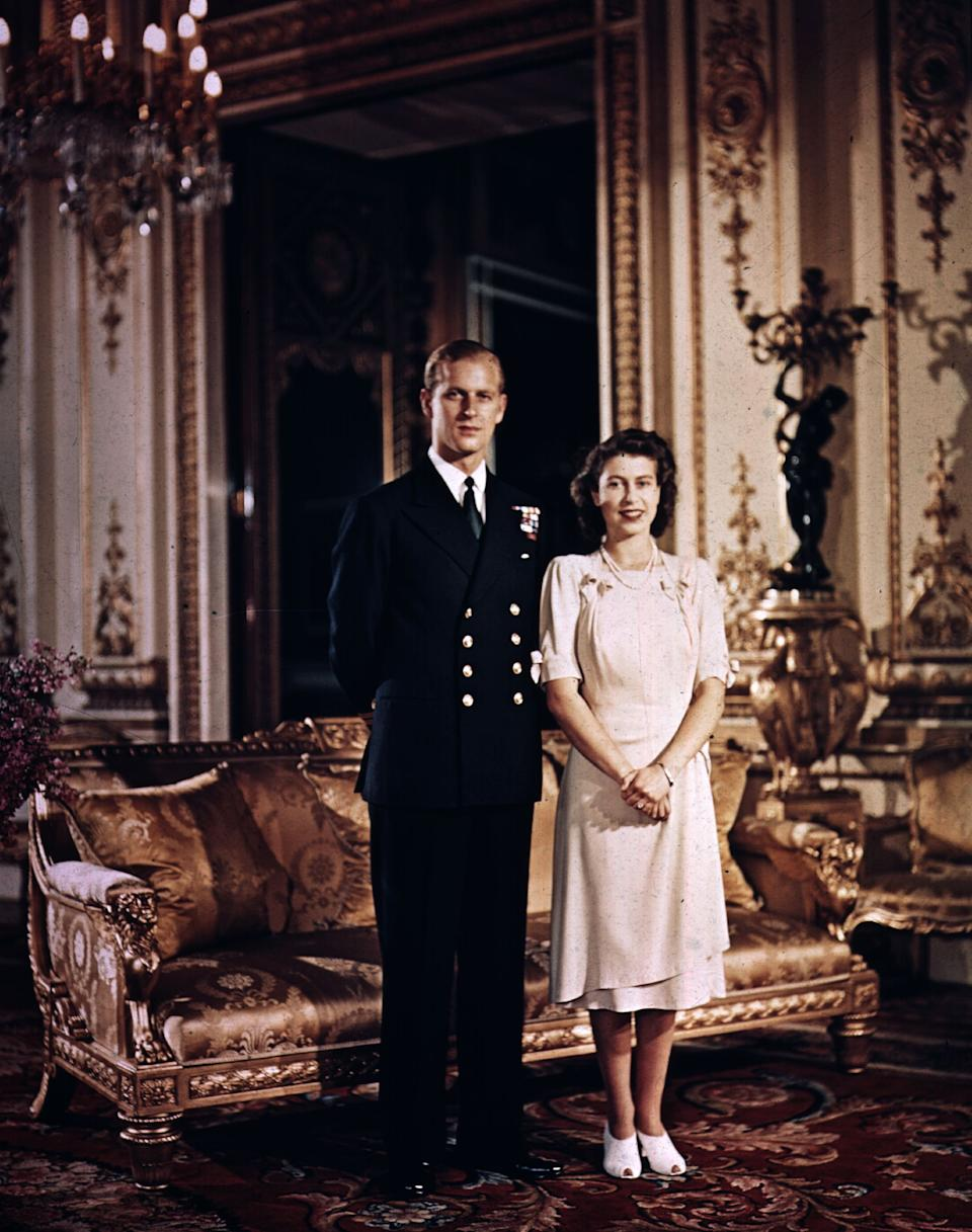 1947: Princess Elizabeth and Prince Philip, Duke of Edinburgh at Buckingham Palace shortly before their wedding. (Photo by Hulton Archive/Getty Images)