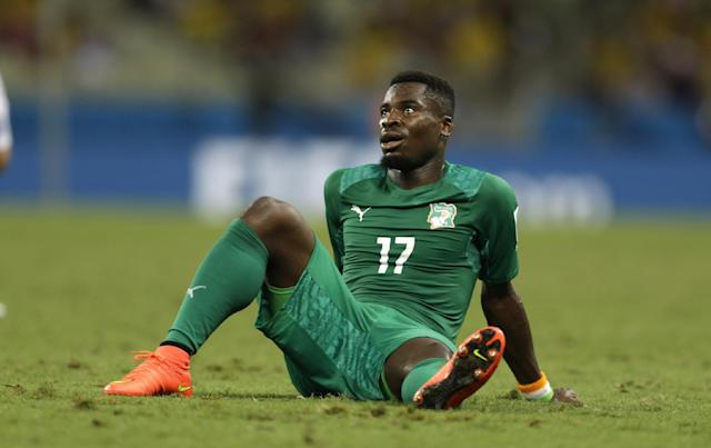 Ivory Coast's Serge Aurier sits on the ground after losing 1-2 in the group C World Cup soccer match between Greece and Ivory Coast at the Arena Castelao in Fortaleza, Brazil, Tuesday, June 24, 2014. (AP Photo/Natacha Pisarenko)