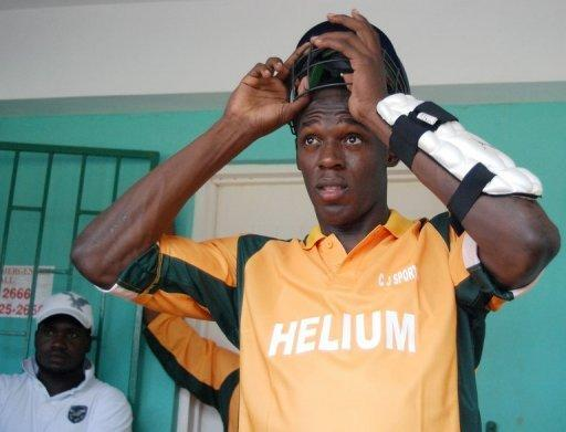 File photo shows cricket-mad sprint king Usain Bolt at a charity invitational celebrity cricket match in Jamaica in 2009. According to Australian media, Bolt clean bowled the then West Indies captain Chris Gayle in a charity match in 2009, having earlier hit him down the ground for six