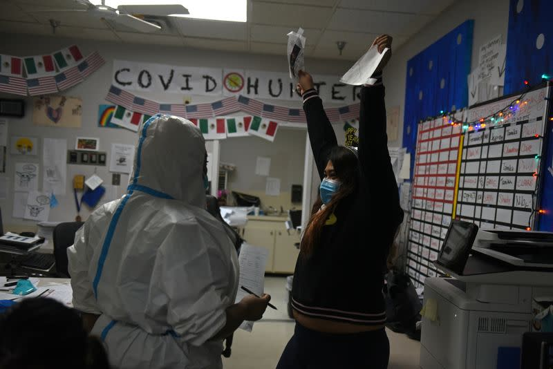 Healthcare workers treat COVID-19 patients on New Year's Eve in Houston