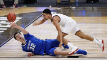 Creighton center Ryan Kalkbrenner (32) and Gonzaga guard Jalen Suggs (1) chase a loose ball in the second half of a Sweet 16 game in the NCAA men's college basketball tournament at Hinkle Fieldhouse in Indianapolis, Sunday, March 28, 2021. (AP Photo/AJ Mast)