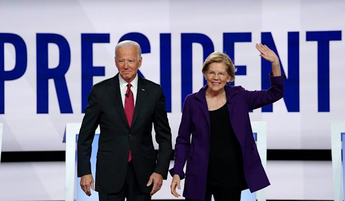 Democratic presidential candidates former Vice President Joe Biden and Senator Elizabeth Warren pose together at the start of the fourth U.S. Democratic presidential candidates 2020 election debate at Otterbein University in Westerville, Ohio U.S., October 15, 2019.