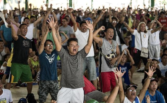When Manny Pacquiao's victory was sealed in the seventh round by technical knockout, fans around the Philippines jumped to their feet and roared with joy (AFP Photo/NOEL CELIS)