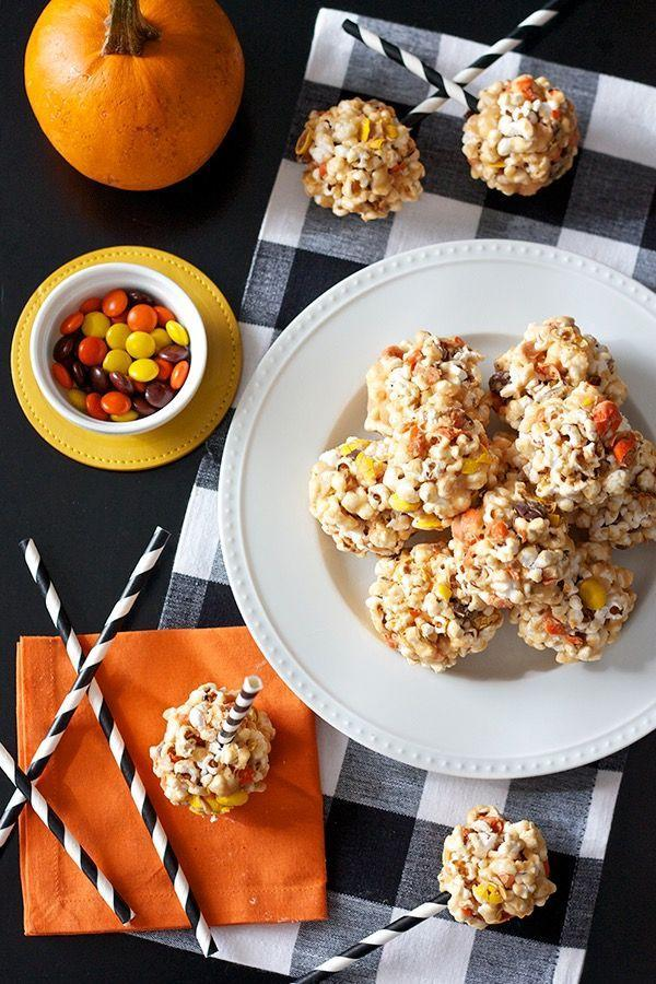 """<p>Reese's Pieces and popcorn are oh-so-divine together. Make popcorn balls, or add a stick to create a popcorn ball pop.</p><p><a class=""""link rapid-noclick-resp"""" href=""""http://www.ericasweettooth.com/2014/10/peanut-butter-popcorn-balls.html"""" rel=""""nofollow noopener"""" target=""""_blank"""" data-ylk=""""slk:GET THE RECIPE"""">GET THE RECIPE</a></p>"""