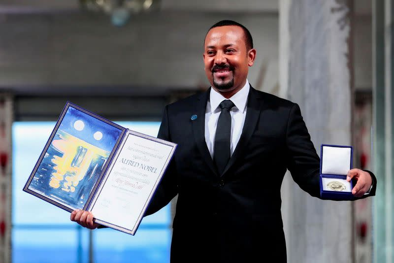 FILE PHOTO: FILE PHOTO: Ethiopian Prime Minister Abiy Ahmed Ali poses with medal and diploma after receiving Nobel Peace Prize during ceremony in Oslo City Hall
