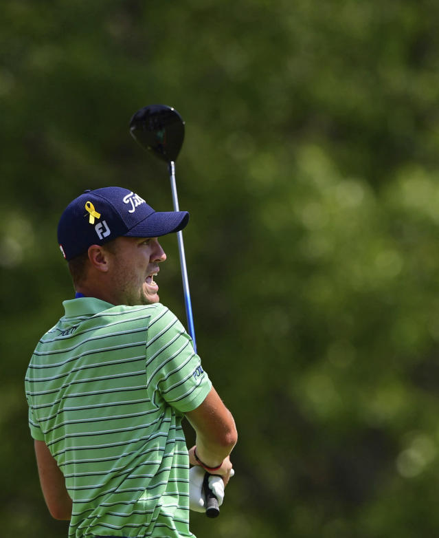 Justin Thomas reacts to his tee shot on the sixth hole during the final round of the Bridgestone Invitational golf tournament at Firestone Country Club, Sunday, Aug. 5, 2018, in Akron, Ohio. (AP Photo/David Dermer)