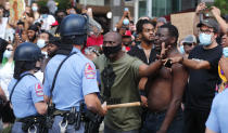 Demonstrators stand off with police in downtown Raleigh, N.C. Saturday, May 30, 2020, during a protest over the death of George Floyd, who died in police custody on Memorial Day in Minneapolis.(Ethan Hyman/The News & Observer via AP)