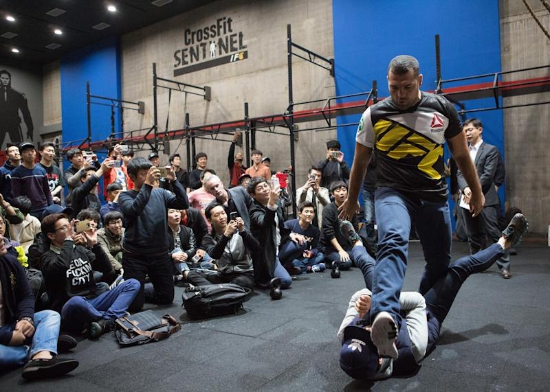 SEOUL, SOUTH KOREA - OCTOBER 29: Mauricio Rua demonstrates a martial arts technique with a fan during a fan meeting at Reebok Crossfit Sentinel Gym Uptown on October 29, 2015 in Seoul, South Korea. (Photo by Christopher Jue /Zuffa LLC/Zuffa LLC via Getty Images)