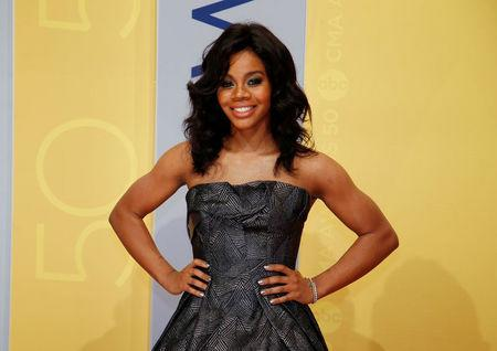 FILE PHOTO - Gymnast Gabby Douglas arrives at the 50th Annual Country Music Association Awards in Nashville, Tennessee, U.S., November 2, 2016. REUTERS/Jamie Gilliam/File Photo