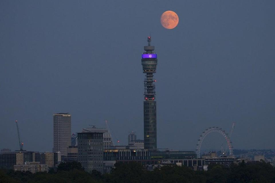 The moon rises over the BT Tower in central London (Hollie Adams/PA) (PA Wire)