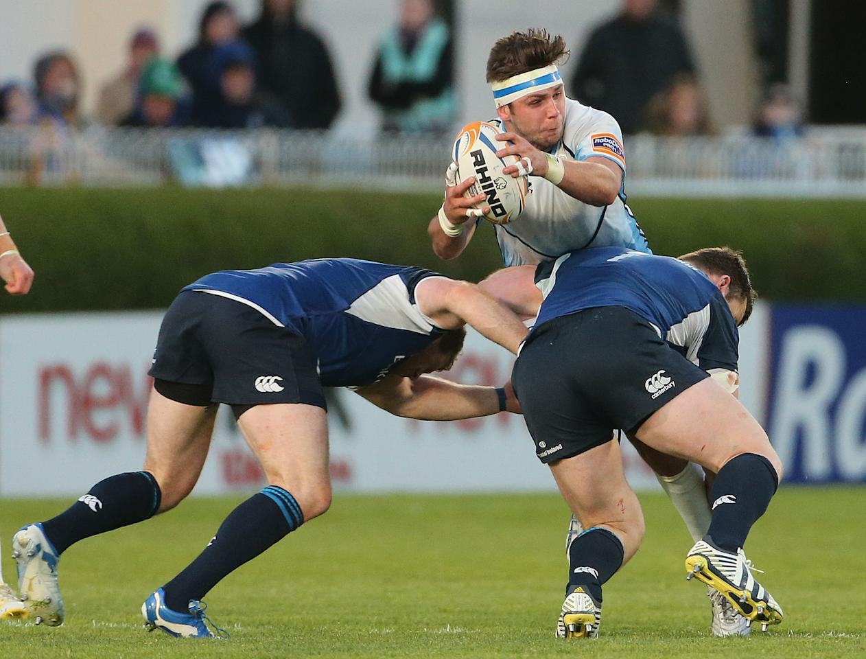 Leinster's Sean Cronin and Cian Healy tackle Glasgow Warriors' Ryan Wilson during the Rabo Direct PRO12 Playoff match at the RDS, Dublin.