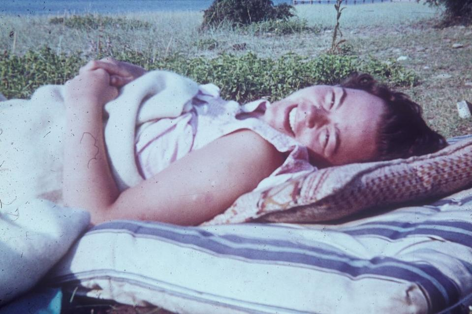 Wendy Scott lying on a mattress on the beach by the Black Sea