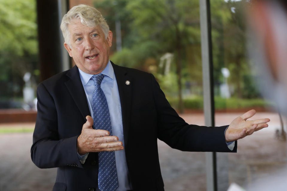 Virginia Attorney General Mark Herring gestures as he speaks with reporters ouside Richmond General District Court Thursday June 18, 2020, in Richmond, Va. Herring responded to questions concerning a judge' extension of an injunction preventing the removal of the statue of Confederate General Robert E. Lee on Monument Ave. in Richmond.(AP Photo/Steve Helber)