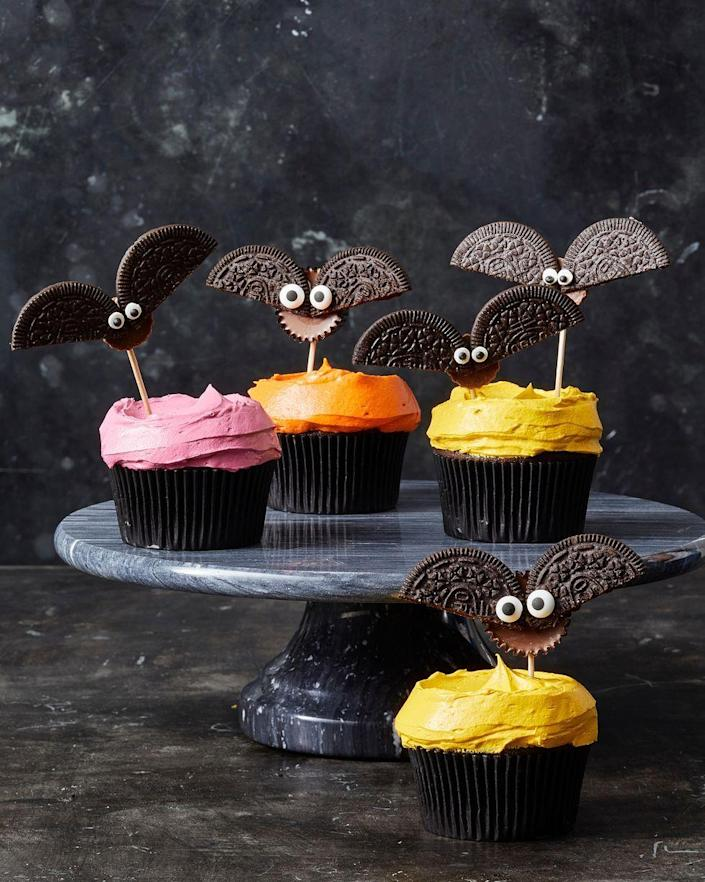 """<p>For an easy (and edible!) craft idea, make cute bats out of Oreos and peanut butter cups.</p><p>Get the recipe from <a href=""""https://www.goodhousekeeping.com/food-recipes/party-ideas/a28593120/cookie-bat-cupcakes-recipe/"""" rel=""""nofollow noopener"""" target=""""_blank"""" data-ylk=""""slk:Good Housekeeping"""" class=""""link rapid-noclick-resp"""">Good Housekeeping</a>.</p>"""