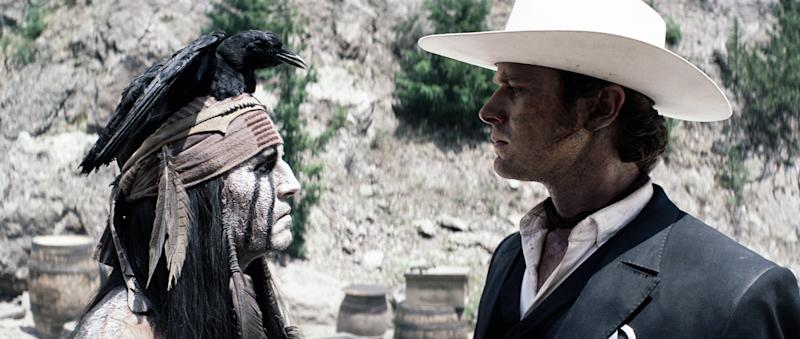 """This film publicity image released by Disney shows Johnny Depp as Tonto, left, and Armie Hammer as The Lone Ranger, in a scene from """"The Lone Ranger."""" (AP Photo/Disney Enterprises, Inc.)"""