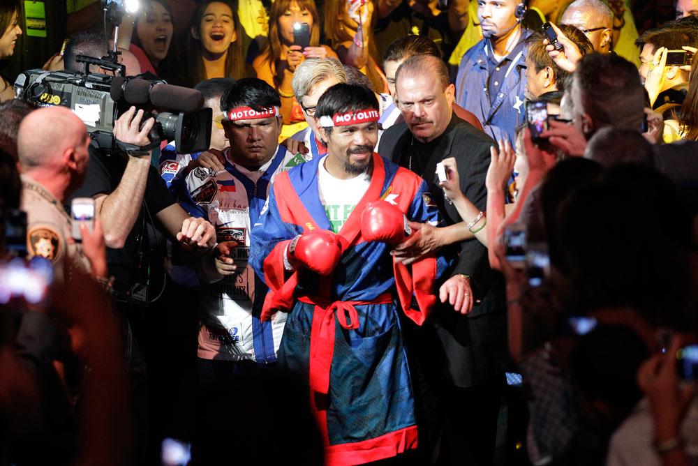 Manny Pacquiao, from the Philippines, arrives for his WBO welterweight title fight against Timothy Bradley, from Palm Springs, Calif., Saturday, June 9, 2012, in Las Vegas.