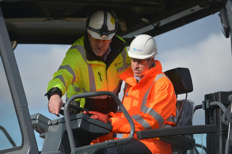 The Duke of Cambridge (right) operating an asphalt paver during a visit to the Tarmac National Skills and Safety Park in Nottinghamshire.