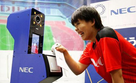 NEC Red Rockets' volleyball player Haruyo Shimamura demonstrates the face recognition system for Tokyo 2020 Olympics and Paralympics, which is developed by NEC corp, in Tokyo, Japan August 7, 2018. REUTERS/Toru Hanai